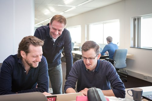 "Duke Prins (centre) during a work meeting at Payconiq: ""We need to grow very big very quickly. Only the large players will survive."""