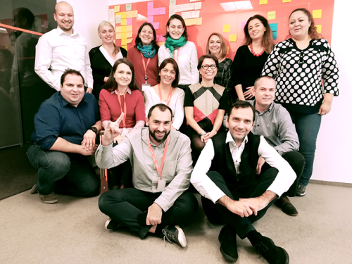 The tribe leads, product owners, chapter leads, Agile coaches and communications colleagues who are implementing the one WoW in Romania. Alina is standing third left.