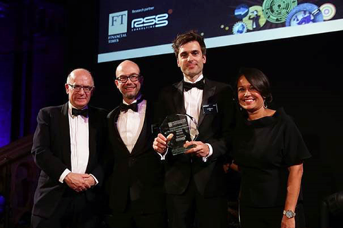 ING's Michiel de Vries (second from left) and Luc Driessen (second from right) receive their  award for innovation in strategy and changing behaviours from the FT's Michael Skapinker (left) and RSG Consulting's Reena SenGupta (right).