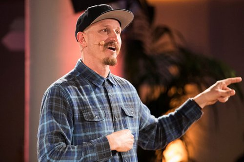Mick Ebeling of Not Impossible gives a keynote during the summit.