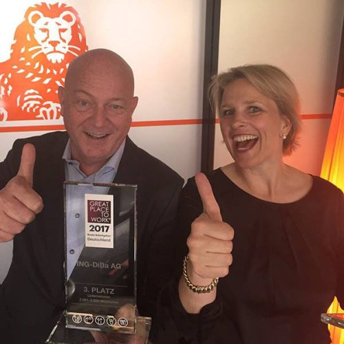 ING in Germany's Kees de Knegt and Corinna Vogtare are all smiles after ING was ranked </br>the third best employer in Great Place to Work's 2001 to 5,000 employee category.